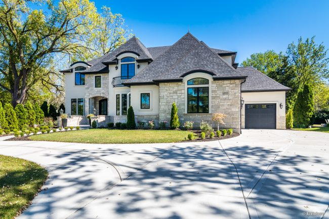 Front view of a new luxury home photographed by XL Visions